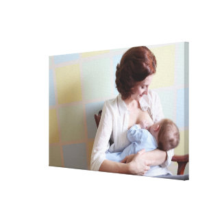 young mother breast feeding her baby boy canvas print