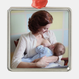 young mother breast feeding her baby boy christmas ornament