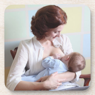 young mother breast feeding her baby boy coaster