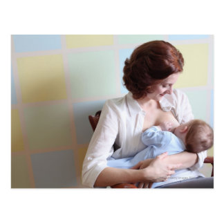 young mother breast feeding her baby boy postcard