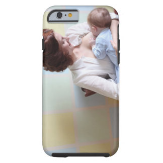 young mother breast feeding her baby boy tough iPhone 6 case