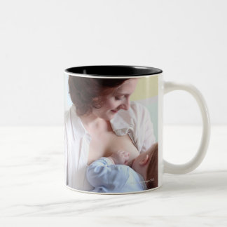young mother breast feeding her baby boy Two-Tone coffee mug