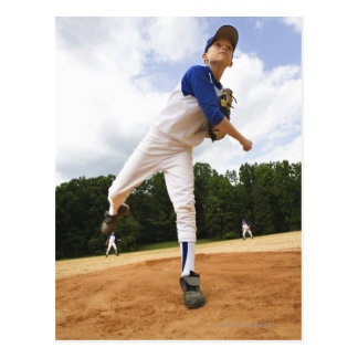 Young pitcher throwing baseball from mound postcard