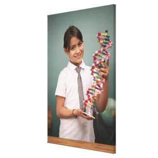 Young schoolgirl holds a colorful model canvas print