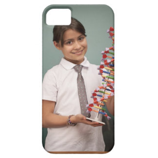 Young schoolgirl holds a colorful model case for the iPhone 5