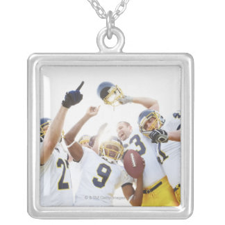 Young sportsmen playing rugby silver plated necklace