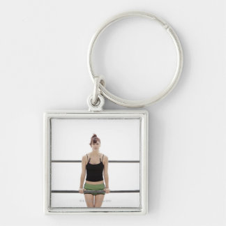 young sporty woman on a holm outside keychains