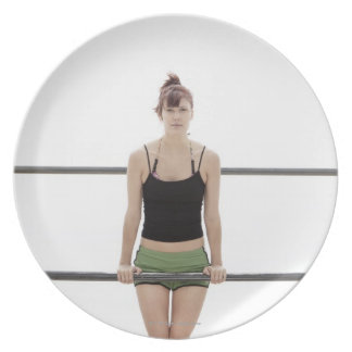 young sporty woman on a holm outside plate