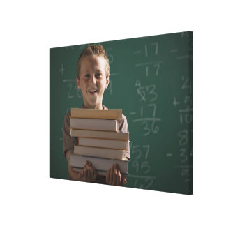 Young student in classroom canvas prints