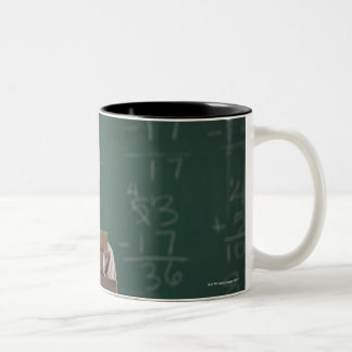 Young student in classroom Two-Tone coffee mug
