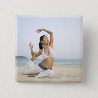 Young woman doing yoga on the beach 15 cm square badge
