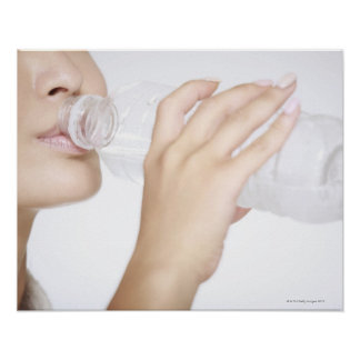 young woman drinking water,close-up poster