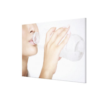 young woman drinking water,close-up stretched canvas prints