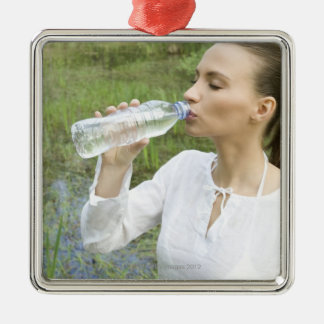 young woman drinking water from bottle christmas ornament