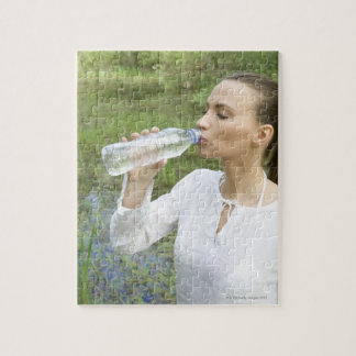 young woman drinking water from bottle jigsaw puzzle