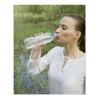 young woman drinking water from bottle poster