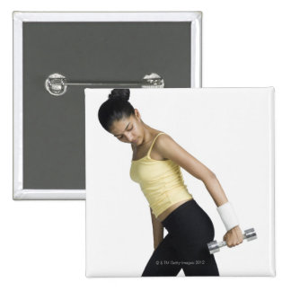 Young woman exercising with a dumbbell 15 cm square badge