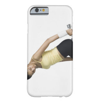 Young woman exercising with a dumbbell barely there iPhone 6 case