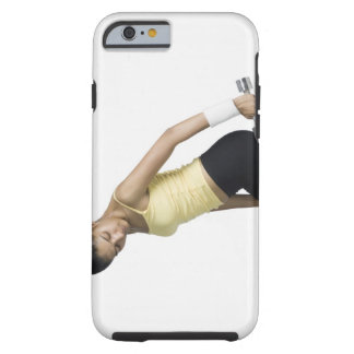 Young woman exercising with a dumbbell tough iPhone 6 case