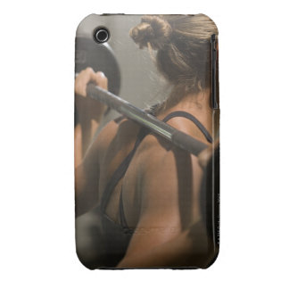 Young woman exercising with barbell, rear view iPhone 3 cases