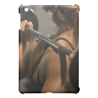 Young woman exercising with barbell, rear view iPad mini cover