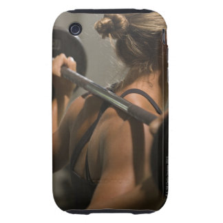 Young woman exercising with barbell, rear view iPhone 3 tough covers