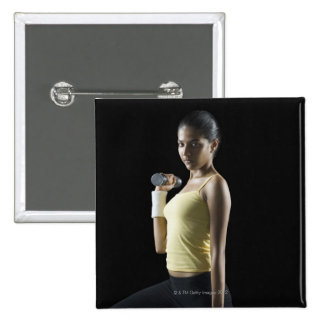 Young woman exercising with dumbbells 15 cm square badge