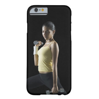 Young woman exercising with dumbbells barely there iPhone 6 case