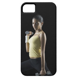 Young woman exercising with dumbbells case for the iPhone 5