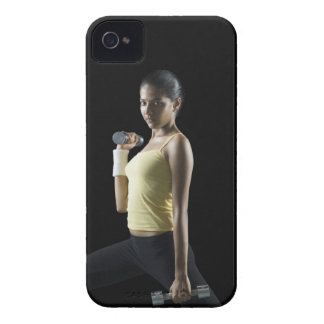 Young woman exercising with dumbbells iPhone 4 cases