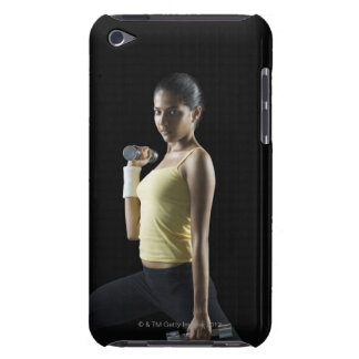 Young woman exercising with dumbbells iPod touch cover