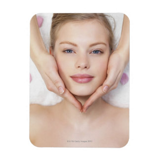 Young woman getting massage rectangular photo magnet