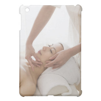 Young woman having facial massage case for the iPad mini