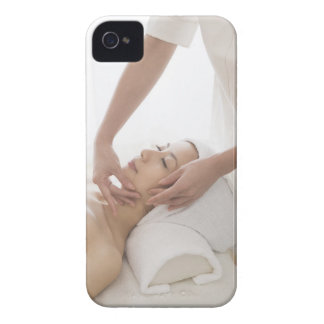 Young woman having facial massage iPhone 4 cases