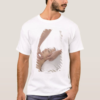 Young woman having facial massage T-Shirt
