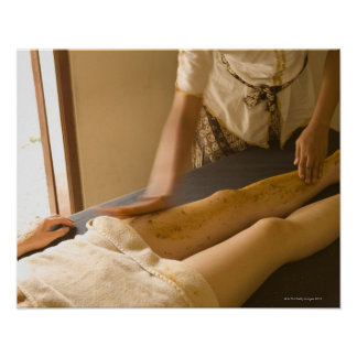 Young woman having leg massage poster