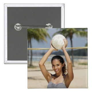 Young woman holding volleyball and smiling at 15 cm square badge