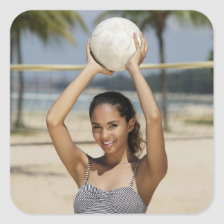 Young woman holding volleyball and smiling at square sticker