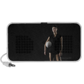 Young woman holding volleyball, portrait mp3 speaker