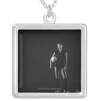 Young woman holding volleyball, portrait silver plated necklace