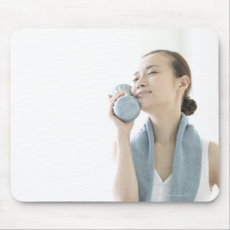 young woman holding water bottle to face mouse pad
