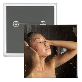 Young woman in shower 15 cm square badge