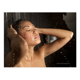 Young woman in shower postcard