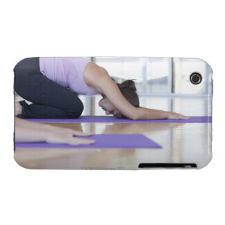 young woman in the downward dog position during iPhone 3 Case-Mate cases
