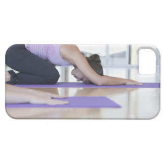 young woman in the downward dog position during iPhone 5 covers