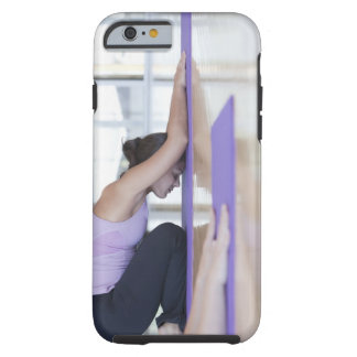 young woman in the downward dog position during tough iPhone 6 case