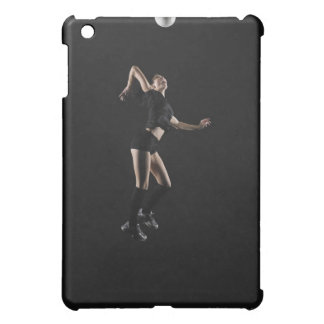 Young woman jumping to hit volleyball, side view iPad mini cover