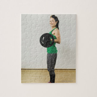Young woman lifting a barbell. jigsaw puzzle