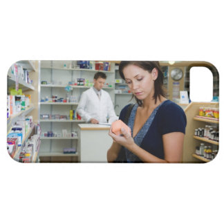 Young woman looking at medicine in pharmacy, iPhone 5 covers