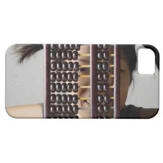 Young woman peering through abacus. barely there iPhone 5 case
